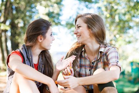 two girlfriends outdoor talking photo