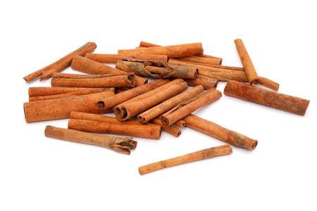 'cinnamon bark': cinnamon bark isolated on white