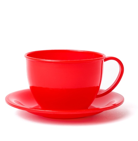 red cup on saucer, toys, isolated on white photo