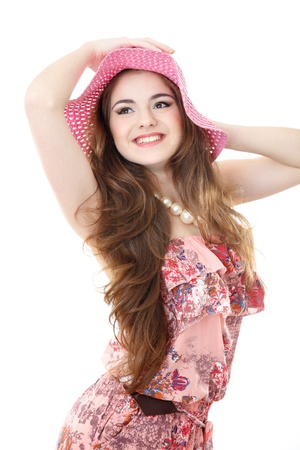 happy young female wearing hat looking sideways isolated on white photo