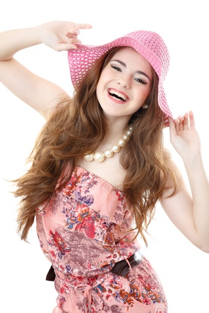 happy laughing young female wearing dress and hat looking at camera isolated on white photo