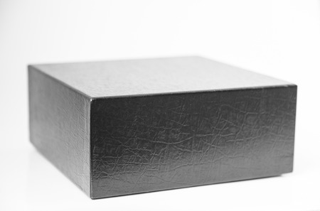 black leather box with texture on white photo