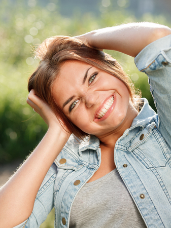 jeanswear: teenage girl with happy crazy face looking at camera