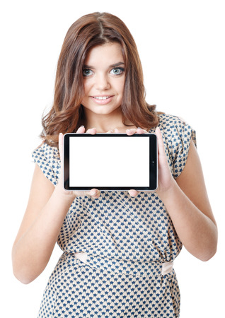 young female showing tablet pc smiling isolated on white focus on tablet photo