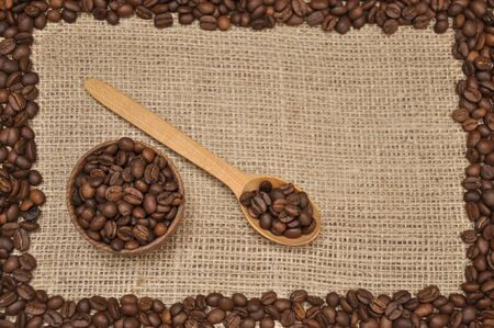 Coffee beans on rag cloth. With frame Imagens