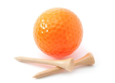 Golf ball with tees. Orange colored ball