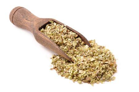 Oregano in wooden scoop