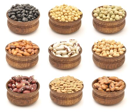 Beans in wooden bowls. Collection