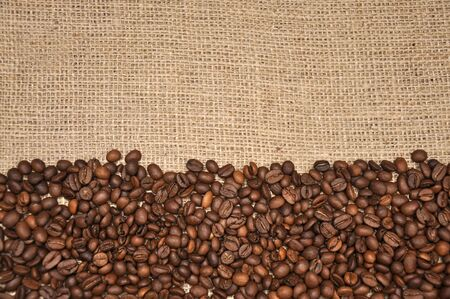 Coffee beans on rag cloth background