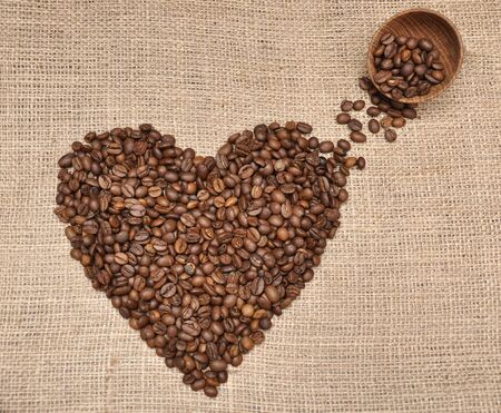 Coffee beans in heart shape. On rag cloth background