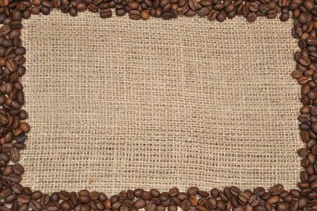 Coffee beans frame on rag cloth background