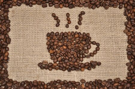 Coffee beans in cup shape. On rag cloth background
