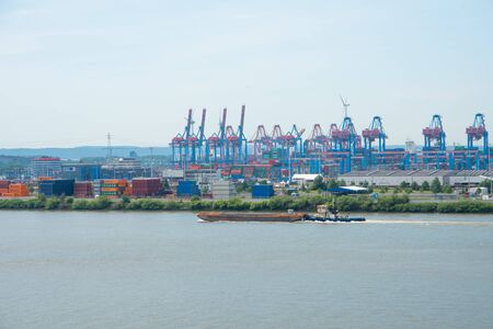 Hamburg port view. Elbe river landscape with container terminal.
