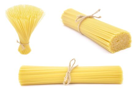 Pasta. Raw italian food isolated on white background Foto de archivo