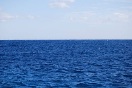 Blue sea with light wavy water. Summer marine background Foto de archivo - 150233104