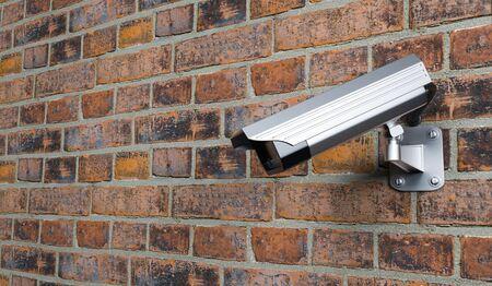 CCTV camera on red brick wall. 3d rendering illustration. Foto de archivo - 150520824