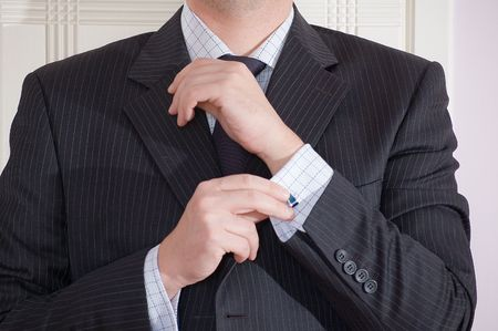 An executive getting dressed to work. photo