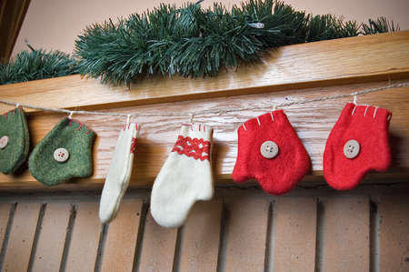 mantelpiece: Colourful Christmas socks hanging on the mantelpiece. Stock Photo