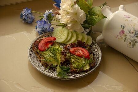 sandwiches with lettuce pate and slices of tomatoes on a plate. Snack Time. Picnic Food