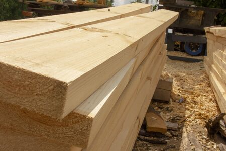 processed boards at a sawmill. Smooth, turned, polished boards at a wood processing plant. wood floor background