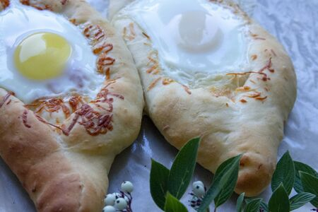homemade baking on parchment. Khachapuri from the oven. Georgian dish.