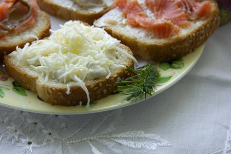 three sandwiches with red fish, one with cheese. snack. Stok Fotoğraf