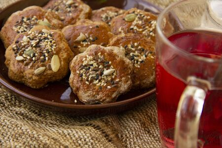 homemade honey cookies with seeds on a plate. tea time. Sweet treat for the holiday.