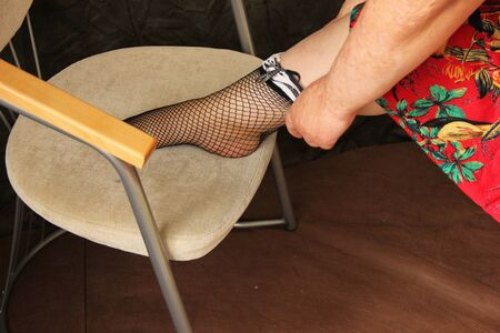 fat woman dresses stockings. shot close up. Hands Scared by Burns