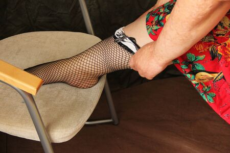 fat woman dresses stockings. shot close up. Hands Scared by Burns.
