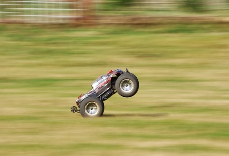 Speeding RC car on the grass