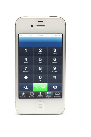 Dial a number on iPhone 4S, white model Stock Photo - 13512345