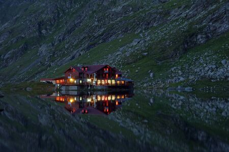 balea: Reflecting chalet in lake (Balea chalet) Stock Photo