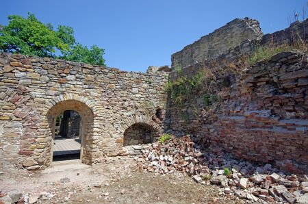 Room ruins in Suceava fortress, medieval construction Stock Photo