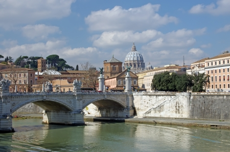 View of Saint Peter Basilica from Tiber river (Ponte Vittorio Emanuelle II) Stock Photo