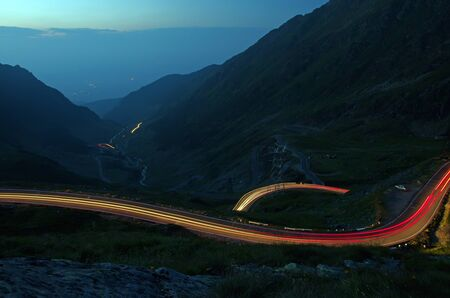 Night curvy road in the mountains, Romania photo