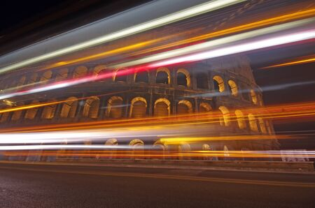 Night traffic at Colosseum, symbol of Rome photo