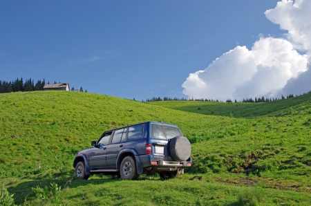 4X4 car outdoor, on a meadow in summer Stock Photo