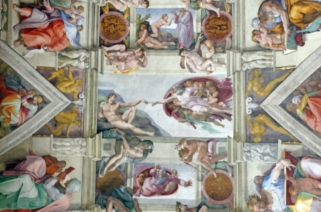 ROME, ITALY - MARCH 08: Michelangelos masterpiece: Sistine Chapel ceiling with Creation of Adam in center on March 08, 2011 in Rome, Italy