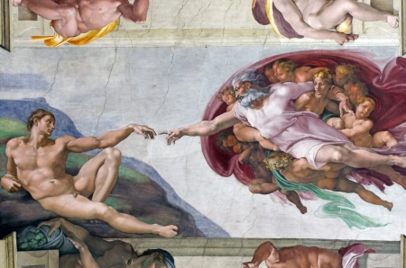 ROME, ITALY - MARCH 08: Michelangelo's masterpiece: The Creation of Adam in Sistine Chapel, Vatican Museum on March 08, 2011 in Rome, Italy