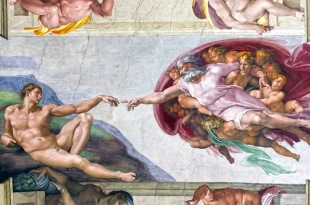 Rome, Italy - March 08, 2011  Creation of Adam by Michelangelo in Sistine Chapel