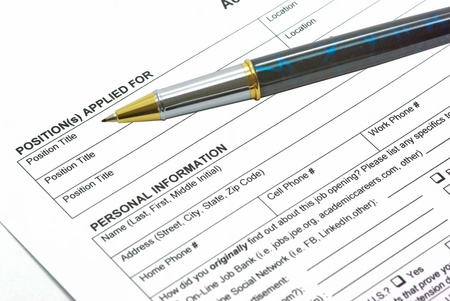 Application form with a pen on it