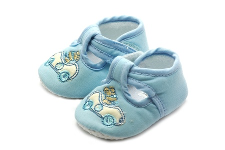 Summer shoe for newborn baby on white photo
