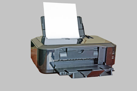 Inkjet black printer isolated on a grey  photo