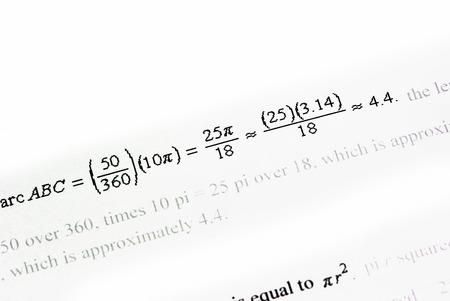 Mathematics calculations on white paper
