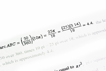Mathematics calculations on white paper