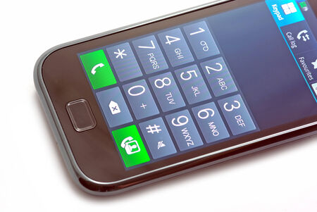 dialing: Dialing a number on mobile phone with touch screen
