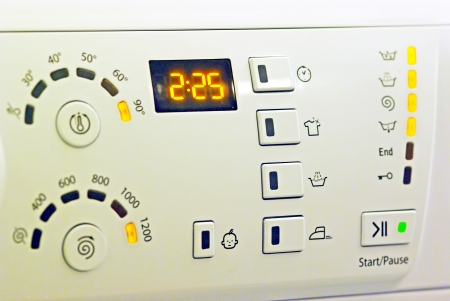 White washing machine control panel, close up image photo