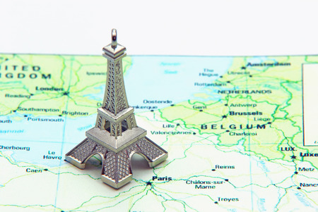 Statue of Eiffel Tower on a map of France photo