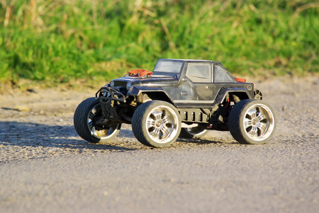 Electric off-road car, radio controlled model on the ground photo