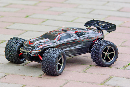 Radio controlled sport car on the pavement  photo
